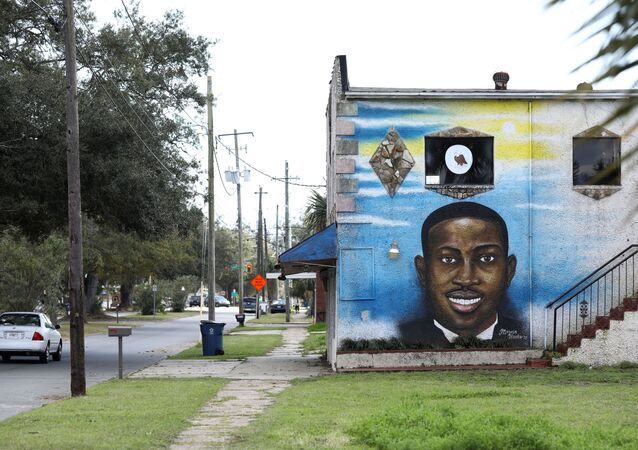 A mural depicts shot Black man Ahmaud Arbery as a Black History Month Memorial Ride is held in memory of those who have died through race-related violence, in Brunswick, Georgia, U.S., February 27, 2021