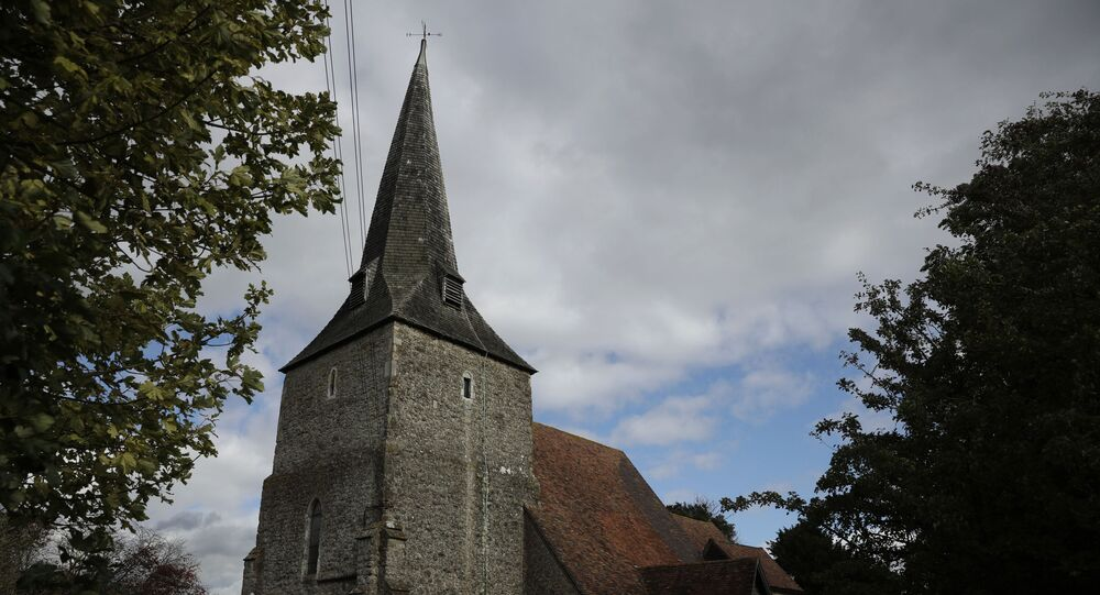 St Mary's Church, of which parts date back to the 12th century, stands neighboring where a post-Brexit customs clearance border post facility is being constructed on land that was previously a field between the villages of Mersham and Sevington in the county of Kent, south east England, Tuesday, Oct. 6, 2020.