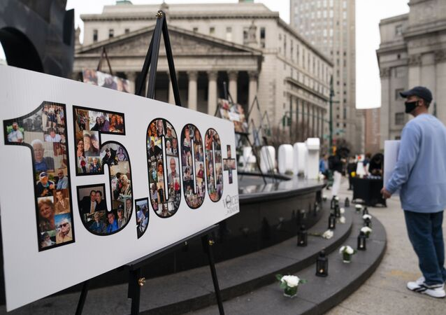 Demonstrators gather beside a presentation depicting the number 15,000 to denote estimated nursing home deaths, before a rally decrying New York Governor Andrew Cuomo's handling of the previous year's outbreak of COVID-19, in New York.