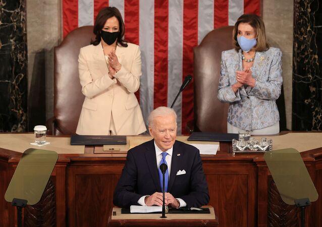 U.S. President Joe Biden addresses a joint session of Congress as President Kamala Harris and Speaker of the House U.S. Rep. Nancy Pelosi (D-CA) react in the U.S. Capitol in Washington, DC, U.S. April 28, 2021.
