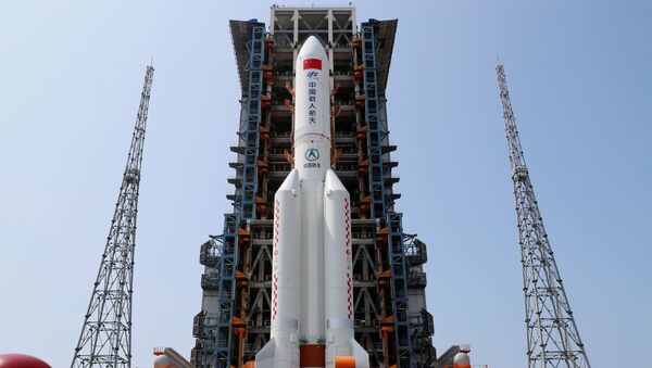 The Long March-5B Y2 rocket, carrying the core module of China's space station Tianhe, sits at the launch pad of Wenchang Space Launch Center in Hainan province, China April 23, 2021. - Sputnik International
