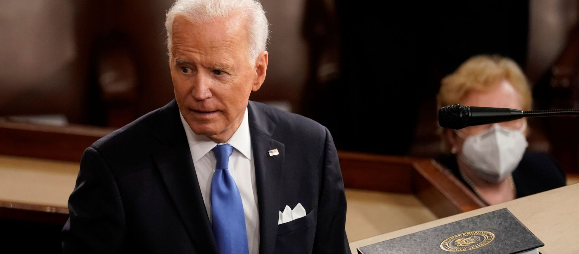 US President Joe Biden turns from the podium after speaking to a joint session of Congress in the House chamber of the US Capitol in Washington, DC, 28 April 2021.  - Sputnik International, 1920, 29.04.2021