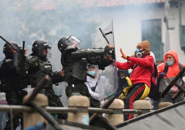 Demonstrators clash with members of security forces during a protest against the tax reform of President Ivan Duque's government in Bogota, Colombia April 28, 2021