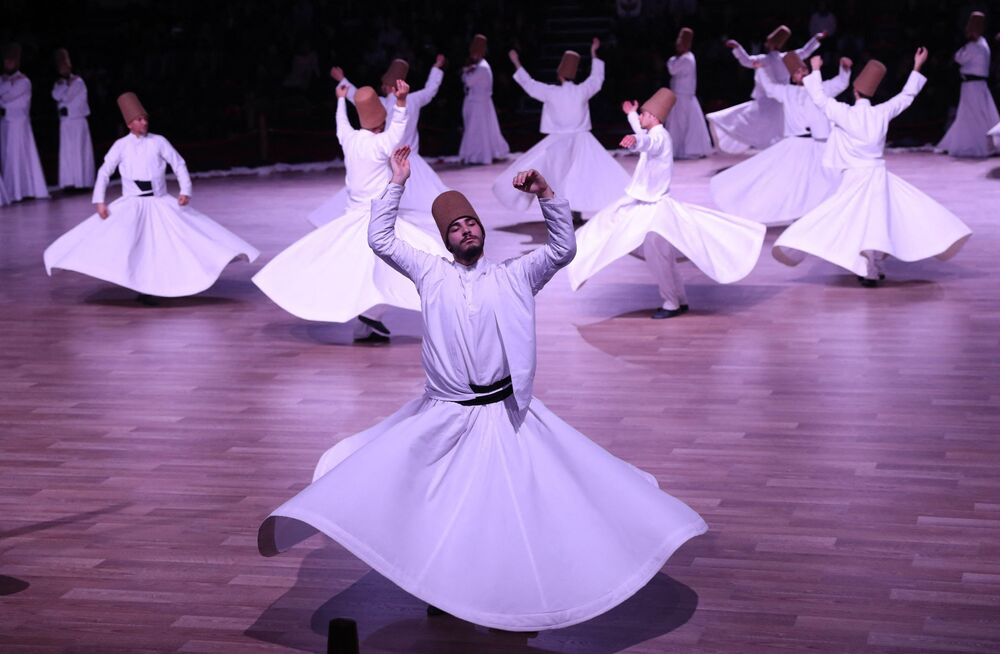 Whirling dervishes perform a Sema during one of the many ceremonies to mark the 744th anniversary of the death of Mevlana Jalaluddin Rumi, the Persian founder of Sufism who lived in the 13th century - at Mevlana Cultural Centre in Konya, Turkey, on 19 December 2017.