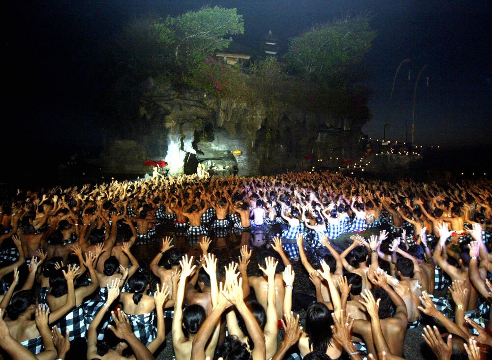 Balinese islanders perform a Kecak dance at Tanah Lot, Tabanan, on the island of Bali, 29 September 2006.  About 5,000 dancers took part in the moment to promote tourism on Bali which has dropped after the two bomb blast attacks in 2002 and 2005.