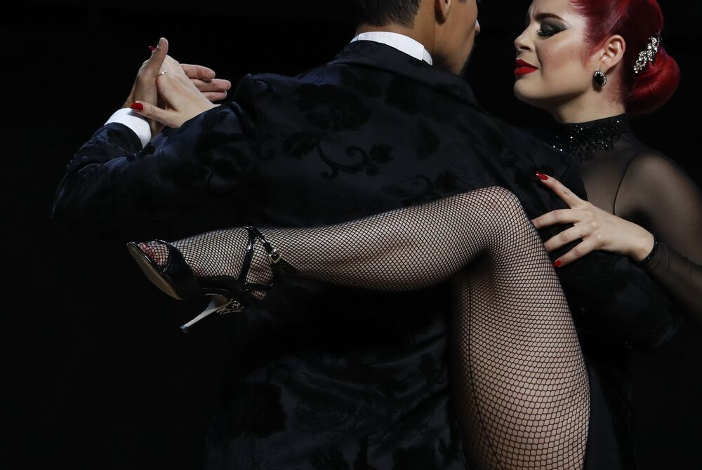 Andres Uran and Estefania Arango, from Colombia, compete in the Stage category final at the annual Tango Dance World Championship in Buenos Aires, Argentina, Wednesday, 21 August 2019.