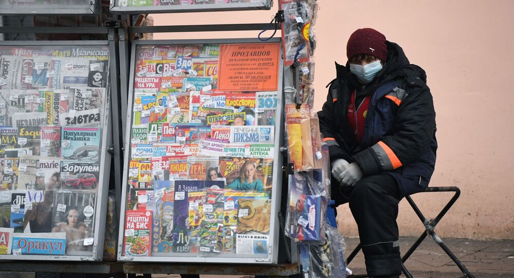 Newspaper vendor in Moscow.