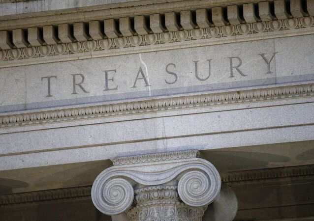 This June 6, 2019, file photo shows the U.S. Treasury Department building at dusk in Washington.  The U.S. Treasury has removed Vietnam and Switzerland from the list of nations labeled as currency manipulators, reversing a decision made by the Trump administration in December
