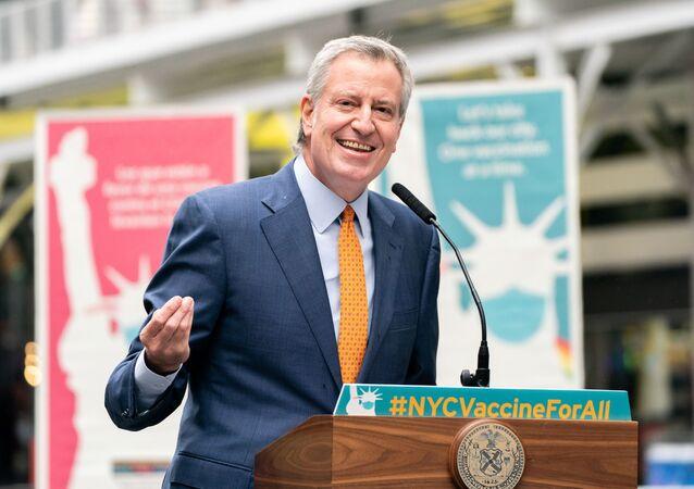 New York City Mayor Bill de Blasio speaks during the opening of the Broadway vaccination site amid coronavirus disease (COVID-19) pandemic in New York City, U.S., April 12, 2021