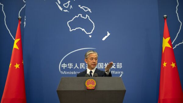 China's Ministry of Foreign Affairs spokesperson Wang Wenbin gestures during a daily briefing at the Ministry of Foreign Affairs in Beijing, Friday, July 24, 2020. - Sputnik International