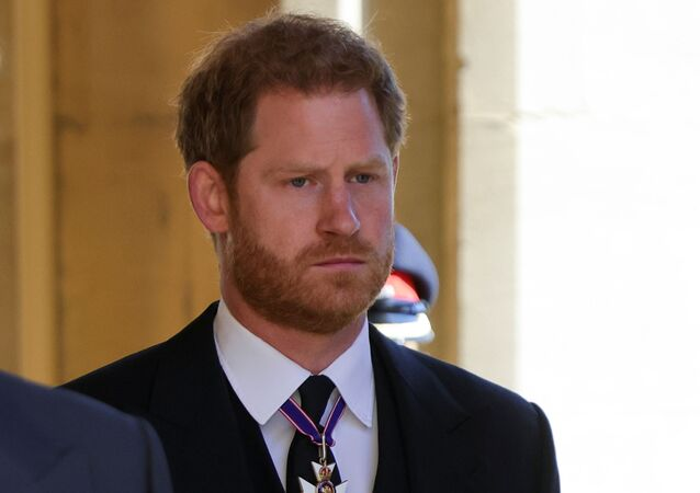 Britain's Prince Harry, Duke of Sussex looks on as he attends the funeral of Britain's Prince Philip, husband of Queen Elizabeth, who died at the age of 99, in Windsor, Britain, 17 April 2021