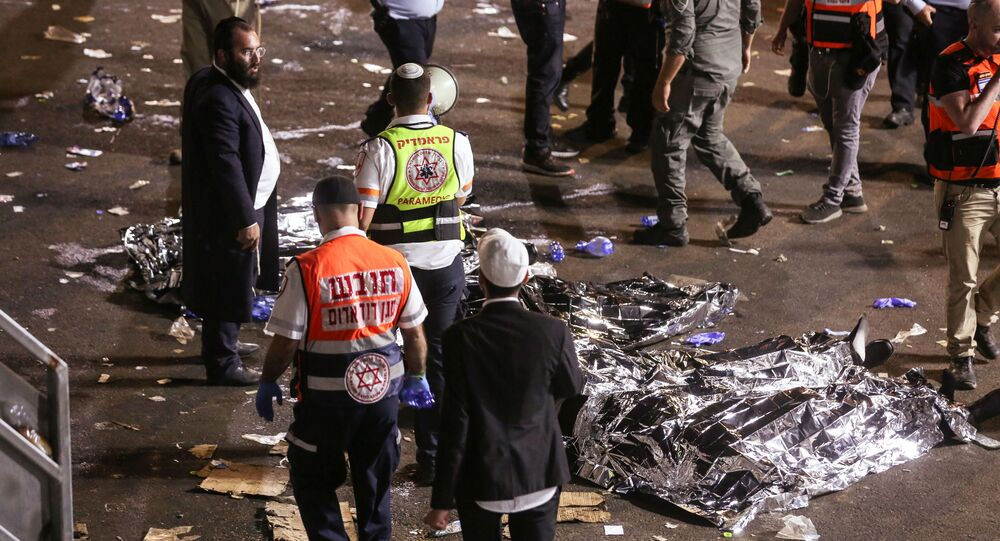 Medics and rescue workers attend to the Lag B'Omer event in Mount Meron, northern Israel, where fatalities were reported among the thousands of ultra-Orthodox Jews gathered at the tomb of a 2nd-century sage for annual commemorations that include all-night prayer and dance, at Mount Meron, Israel April 30, 2021