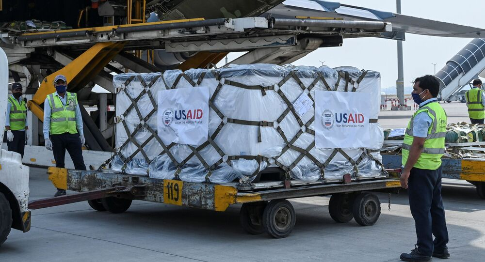 A U.S. Air Force aircraft is seen on the tarmac after landing with coronavirus disease (COVID-19) relief supplies from the United States at the Indira Gandhi International Airport cargo terminal in New Delhi, India