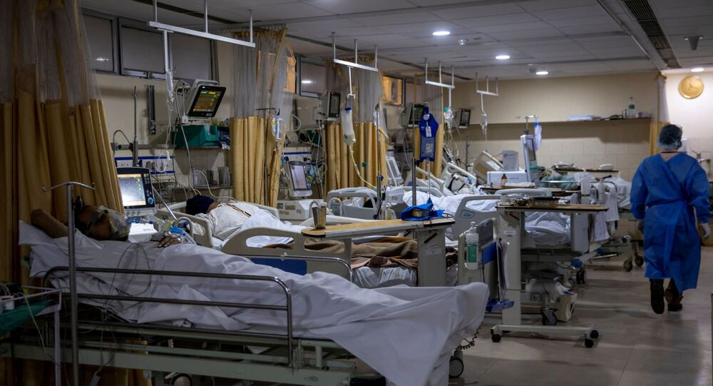 Patients suffering from the coronavirus disease (COVID-19) are seen inside the ICU ward at Holy Family Hospital in New Delhi, India