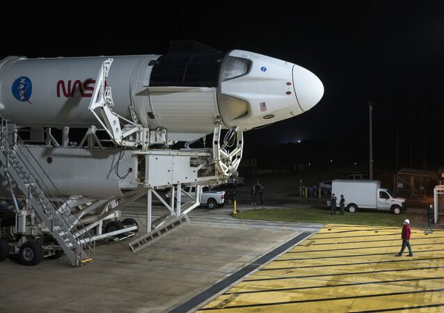 In this Monday, Nov. 9, 2020 photo provided by NASA, a SpaceX Falcon 9 rocket and Crew Dragon capsule is rolled out of the horizontal integration facility at Launch Complex 39A, as preparations continue for a crewed mission at NASA's Kennedy Space Center in Florida.