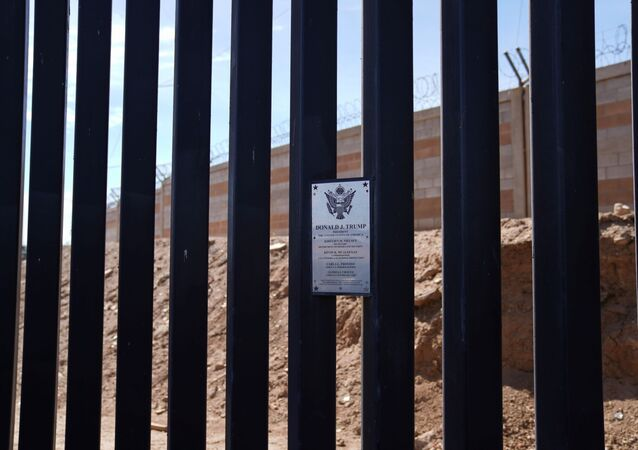 A plaque for former U.S. President Donald Trump is seen at the U.S. border wall in Calexico, California, U.S., April 8, 2021.