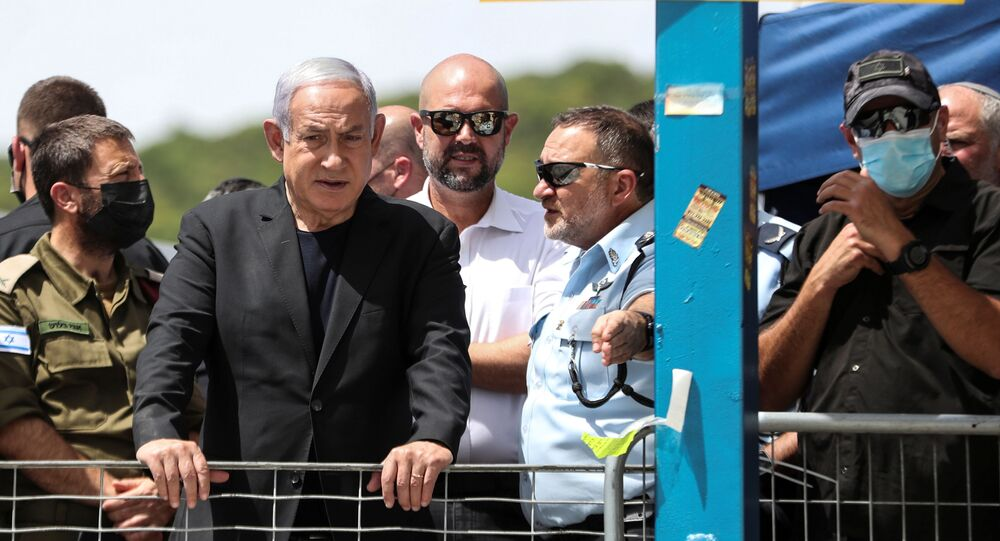 Israeli Prime Minister Benjamin Netanyahu visits Mount Meron, northern Israel, where fatalities were reported among the thousands of ultra-Orthodox Jews gathered at the tomb of a 2nd-century sage for annual commemorations that include all-night prayer and dance, April 30, 2021