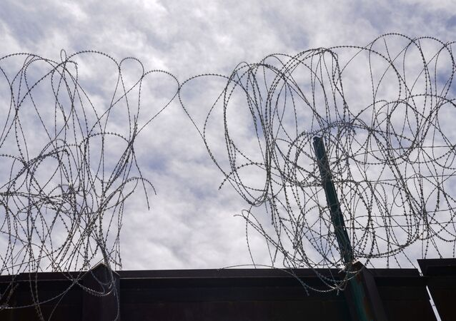 A section of the U.S. border wall razor wire cut by asylum-seeking migrants is seen in Calexico, California, U.S., April 8, 2021.