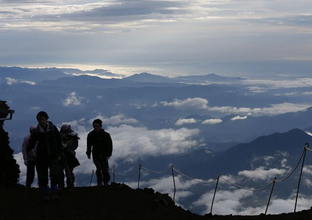 Climbers go up Mount Fuji, in Fujiyoshida city, Yamanashi prefecture, Japan, Thursday, July 4, 2013. Japan's most iconic landmark, Mount Fuji, the 3,776-meter-tall mountain was selected as a World Heritage site in June.
