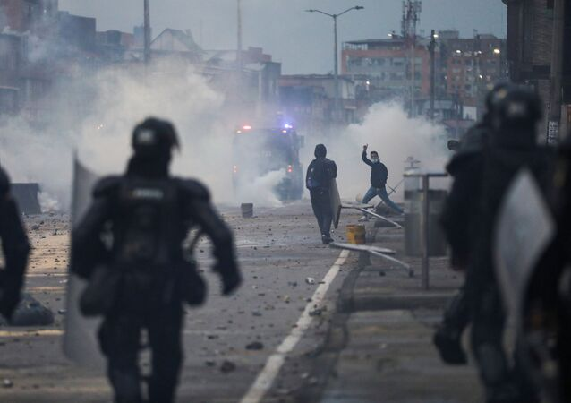 A demonstrator gestures during clashes with security forces during a protest against the tax reform of President Ivan Duque's government in Bogota, Colombia, April 30, 2021.