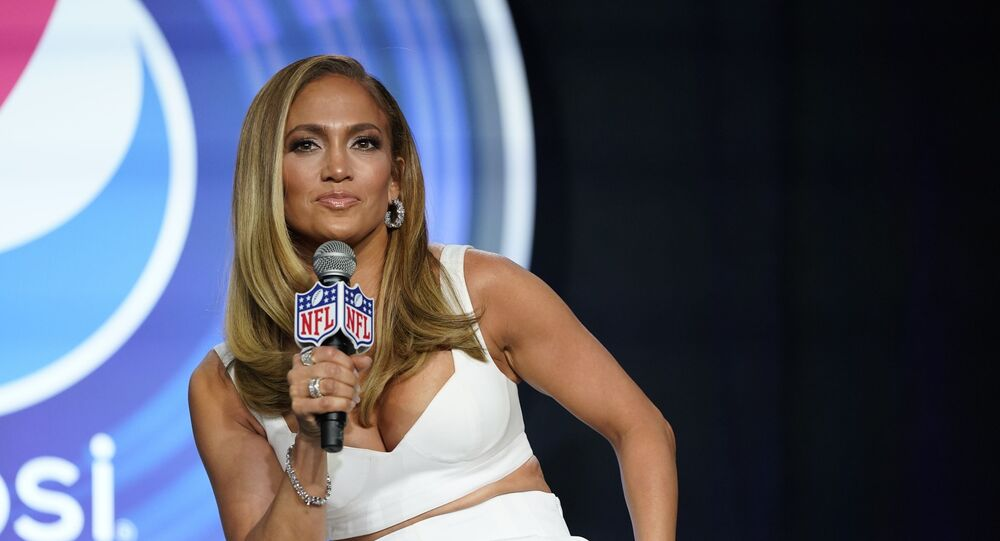 In this Jan. 30, 2020 file photo, NFL Super Bowl 54 football game halftime performer Jennifer Lopez answers questions at a news conference in Miami. Lopez will give a musical performance on the West Front of the U.S. Capitol when Biden is sworn in as the nation's 46th president next Wednesday