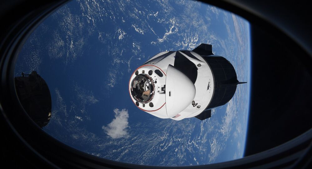 In this Saturday, April 24, 2021 photo made available by NASA, the SpaceX Crew Dragon capsule approaches the International Space Station for docking