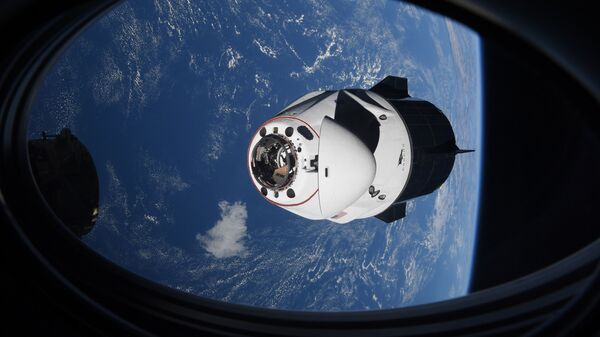 In this Saturday, April 24, 2021 photo made available by NASA, the SpaceX Crew Dragon capsule approaches the International Space Station for docking - Sputnik International