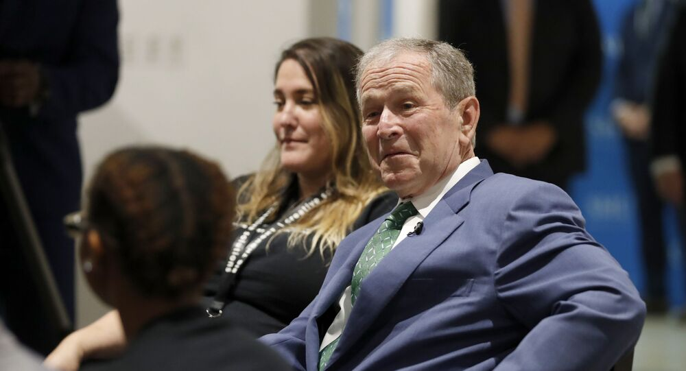 Former President George W. Bush chats with Big Thought staff and youth participants, a non-profit youth program, during a conversation at the Meadows School of the Arts in Dallas, Thursday, June 27, 2019.