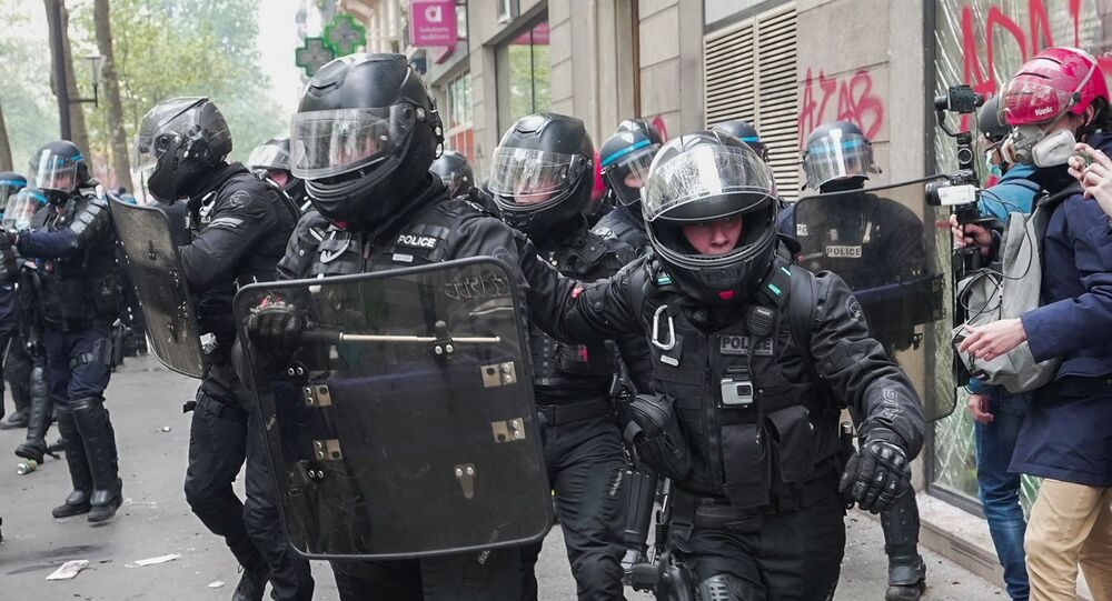 French riot police walk in formation during clashes with protesters as part of the traditional May Day protests, amid the coronavirus disease (COVID-19) outbreak in Paris, France, May 1, 2021.