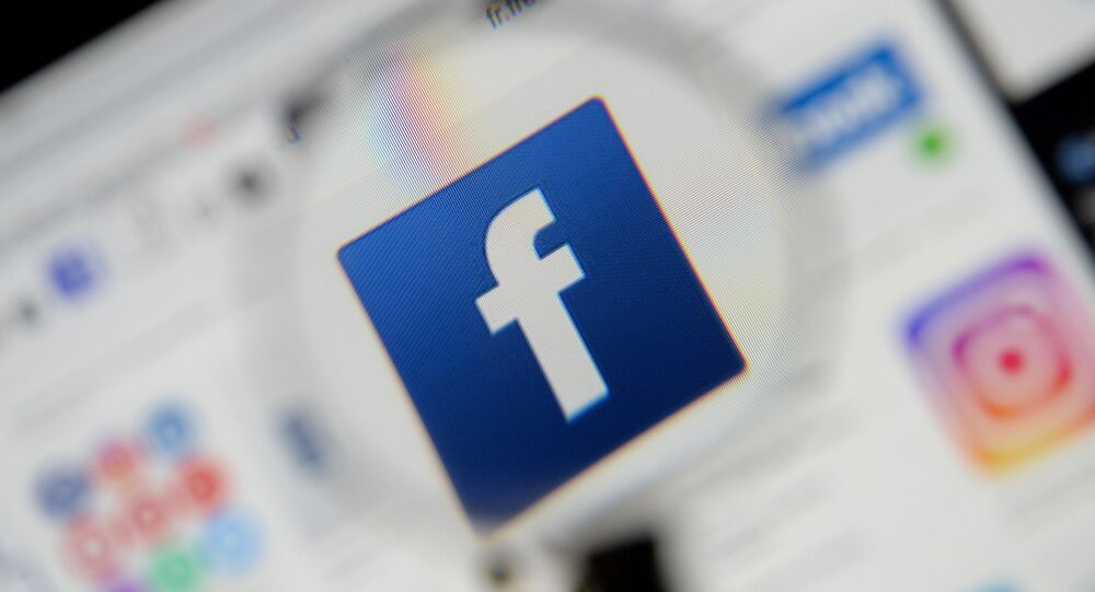 The Facebook logo is seen on a screen in this picture illustration taken December 2, 2019.