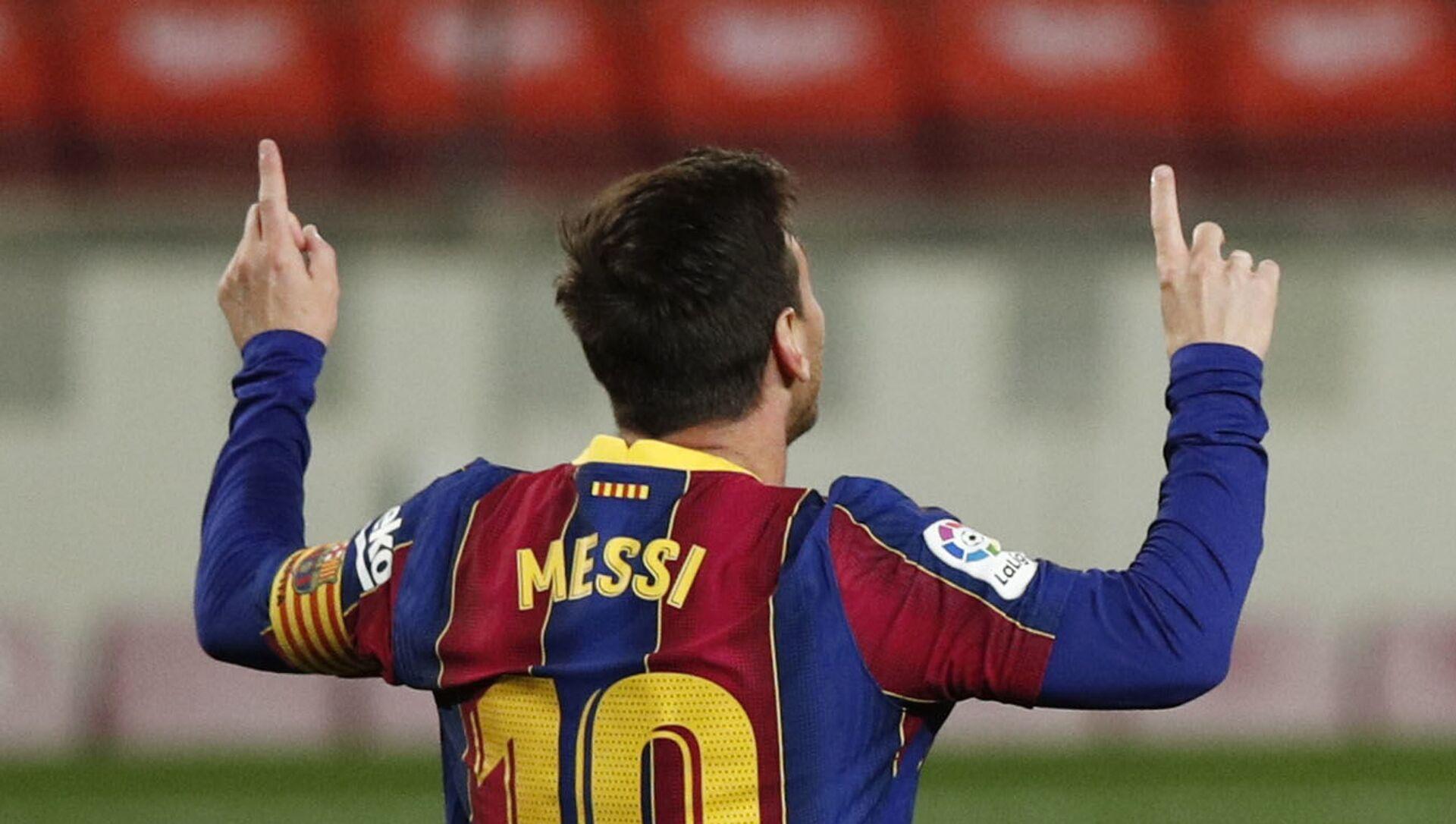 Barcelona's Lionel Messi celebrates scoring their third goal - Sputnik International, 1920, 05.08.2021