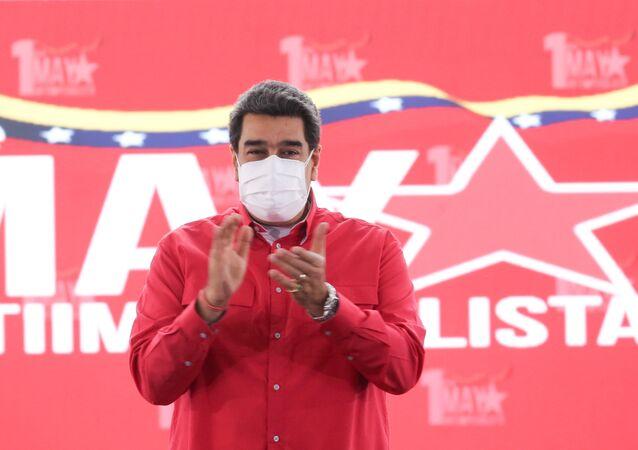 Venezuelan President Nicolas Maduro applauds during an event to mark May Day, in Caracas, Venezuela May 1, 2021.