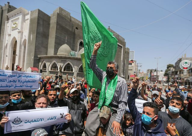 Hamas supporters take part in a protest against Palestinian President Mahmoud Abbas' decision to postpone planned parliamentary elections, in the southern Gaza Strip on April 30, 2021.
