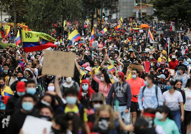 Demonstrators take part in a protest against the tax reform of President Ivan Duque's government in Bogota, Colombia, May 1, 2021.