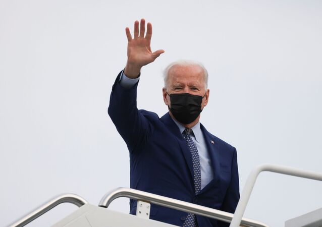U.S. President Joe Biden waves as he boards Air Force One after attending the Democratic National Committee's Back on Track drive-in car rally to celebrate the president's 100th day in office, at Dobbins Air Reserve Base enroute to Joint Base Andrews, in Marietta, Georgia, U.S., April 29, 2021.