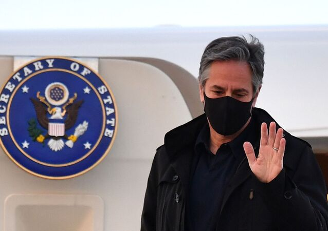 U.S. Secretary of State Antony Blinken gestures as he disembarks after landing at Stansted Airport, outside London, Britain May 2, 2021 ahead of the upcoming G7 foreign ministers meeting.
