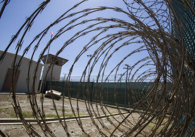 In this Wednesday, April 17, 2019 file photo reviewed by U.S. military officials, the control tower is seen through the razor wire inside the Camp VI detention facility in Guantanamo Bay Naval Base, Cuba.