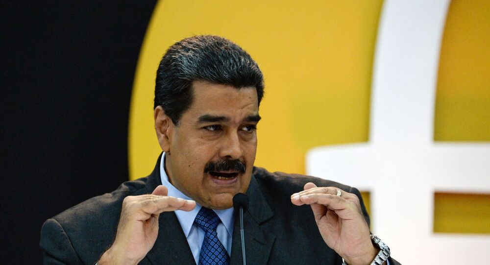 Venezuela's President Nicolas Maduro delivers a speach during a press conference to launch to the market a new oil-backed cryptocurrency called Petro, at the Miraflores Presidential Palace in Caracas, on February 20, 2018