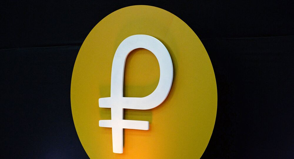 View of the logo of the Petro during a press conference to launch to the market a new oil-backed cryptocurrency called Petro, at the Miraflores Presidential Palace in Caracas, on February 20, 2018