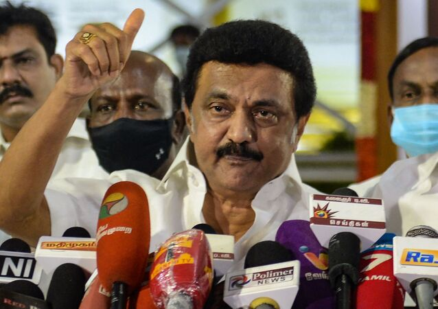 Chief Minister-elect of Tamil Nadu M. K. Stalin of the Dravida Munnetra Kazhagam (DMK) party gestures as he delivers a speech during a press conference after winning the Tamil Nadu State election, at the memorial of his father and late Chief Minister of Tamil Nadu, M. Karunanidhi, in Chennai, on 2 May 2021.