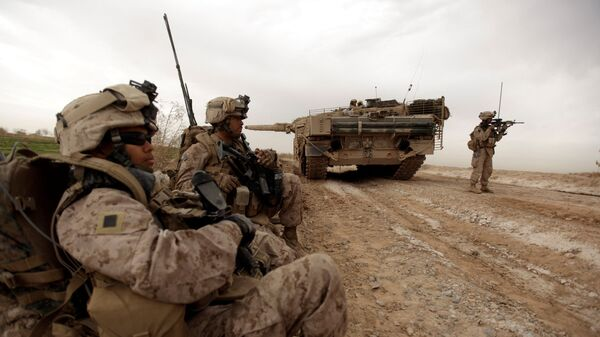 In this file photo taken on February 21, 2010, US marines with 1/3 marine Charlie Company patrol past a Danish army Leopard 2A5EK tank as they clear Improvised Explosive Device (IED)s from a main route in Trikh Nawar on the North Eastern outskirts of Marjah in Afghanistan  - Sputnik International