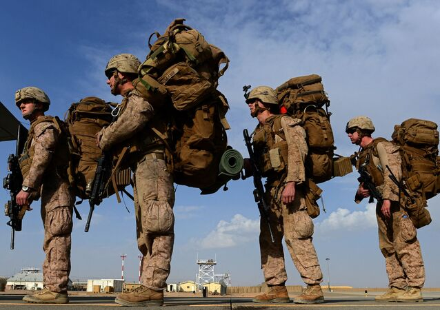 In this file photo taken on October 27, 2014, US Marines board a C-130J Super Hercules transport aircraft headed to Afghanistan's Kandahar as British and US forces withdraw from the Camp Bastion-Leatherneck complex at Lashkar Gah in Helmand province