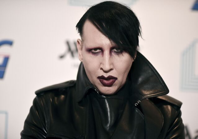 Marilyn Manson attends the 9th annual Home for the Holidays benefit concert in Los Angeles. Detectives are investigating Manson for allegations of domestic violence that reportedly occurred about a decade ago in West Hollywood, authorities said. The domestic violence is believed to have occurred between 2009 and 2011, when Manson lived in the city of West Hollywood.