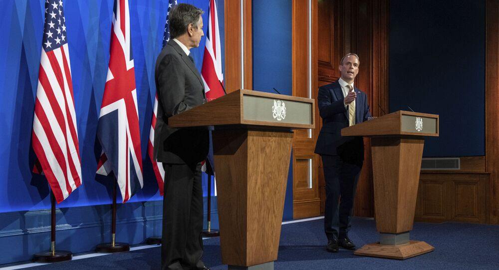Britain's Foreign Secretary Dominic Raab, right, and US Secretary of State Antony Blinken attend a joint press conference at Downing Street in London, Monday, May 3, 2021.