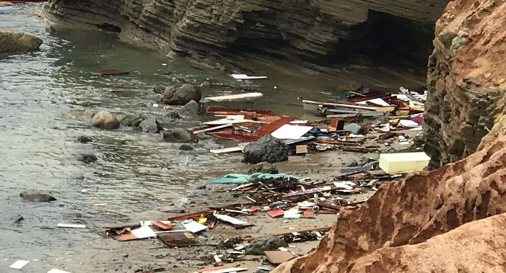 Debris lies in the water after a deadly boat incident, where a 40' cabin cruiser broke up along rocks at Point Loma, San Diego, California, U.S., May 2, 2021 in this image obtained from social media. Picture taken May 2, 2021. San Diego Fire-Rescue Department via REUTERS