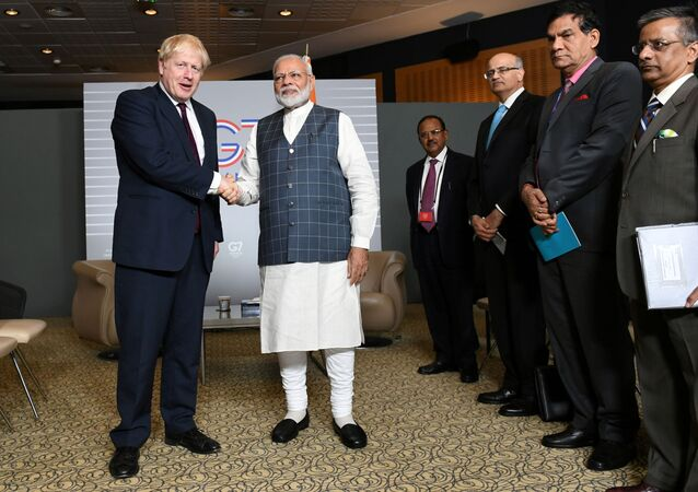 FILE PHOTO: Britain's Prime Minister Boris Johnson meets Indian Prime Minister Narendra Modi at a bilateral meeting during the G7 summit in Biarritz, France August 25, 2019.