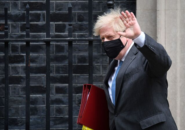 Britain's Prime Minister Boris Johnson leaves 10 Downing Street in central London on April 28, 2021, to take part in the weekly session of Prime Minister's Questions (PMQs) at the House of Commons
