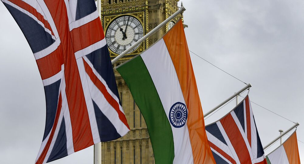 The Union and Indian flags hang near London landmark Big Ben  in Parliament Square in London, Thursday, 12 November 2015.