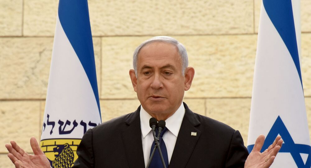 FILE PHOTO: Israeli Prime Minister Benjamin Netanyahu speaks at a ceremony for fallen soldiers of Israel's wars at the Yad Lebanim House on the eve of Memorial Day, in Jerusalem, April 13, 2021.