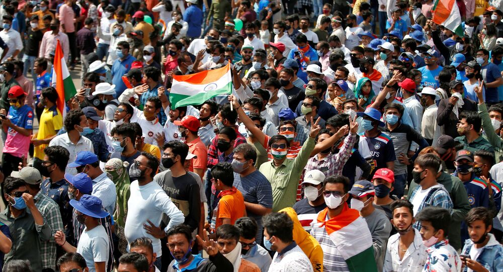 FILE PHOTO: Fans react as they wait to enter the Narendra Modi Stadium before the start of the third test match between India and England in Ahmedabad, India, February 24, 2021.